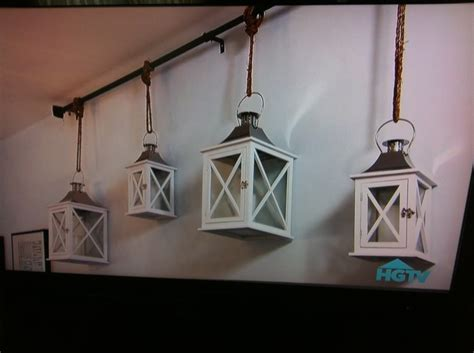 lanterns hung on curtain rod wall decor diy home decor