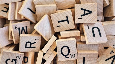 highest letters in scrabble free stock photo of scrabble letters in a pile
