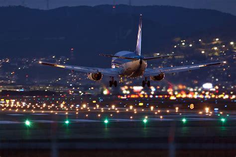 airplane airport landing aircraft lights city