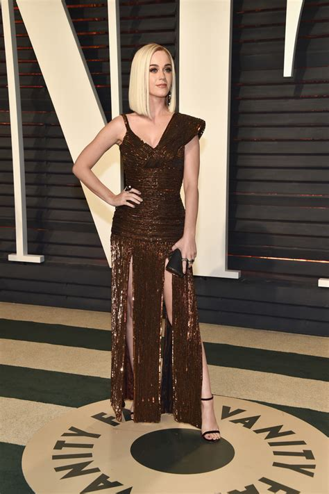 The Oscars Liveblog At Catwalk Shiny Shiny by Katy Perry In An Asymmetrical Bronze Gown The Most