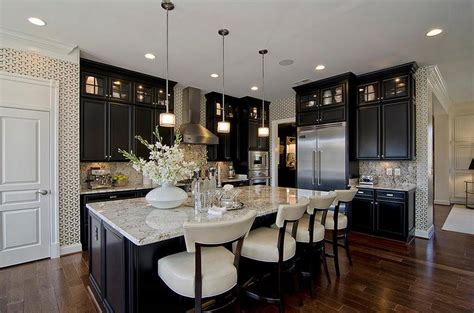 big island kitchen black kitchen cabinetry with marble countertop and backsplash design also a big island
