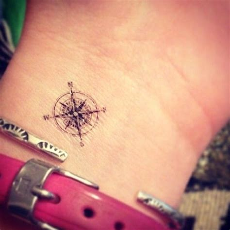 small compass tattoo featuring the small compass from our etsy shop