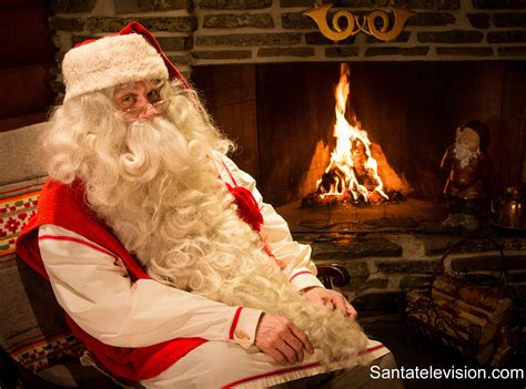 photo santa claus by fireplace in santa claus post office