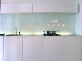 a clear glass backsplash is often seen in modern