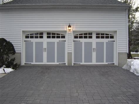 carriage style garage doors with decorative hardware