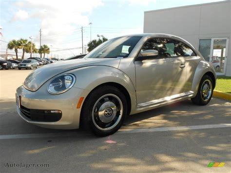 volkswagen beetle   moonrock silver metallic photo   auto jaeger german
