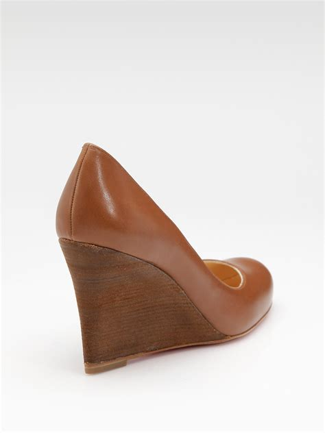 Wedge Pumps christian louboutin miss boxe wedge pumps in brown lyst