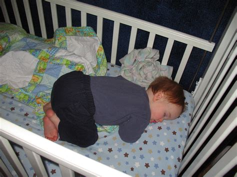 Baby Sleeps On Side In Crib The White Crib Kristen