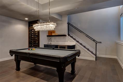 multifunctional contemporary family room in basement