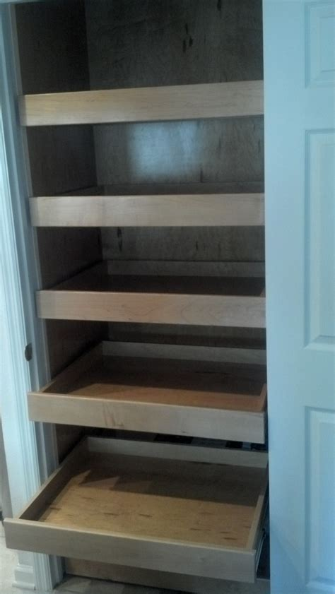 pantry cabinet with sliding shelves around the home