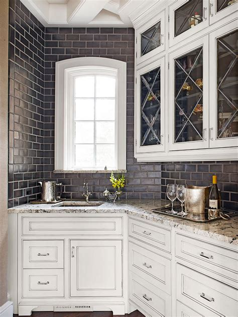 black subway tile backsplash transitional kitchen bhg