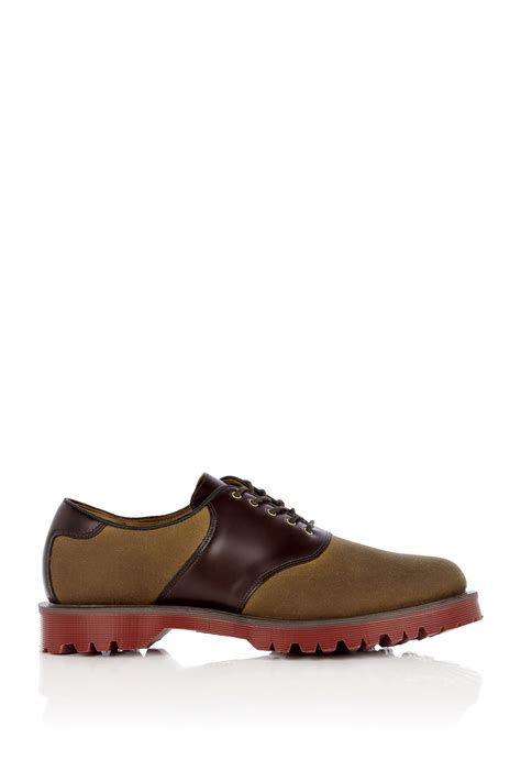 dr martens waxed canvas leather saddle shoes in brown