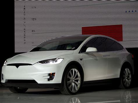 Tesla Car News Tesla Delivers Model X Electric Suv To Take On Luxury