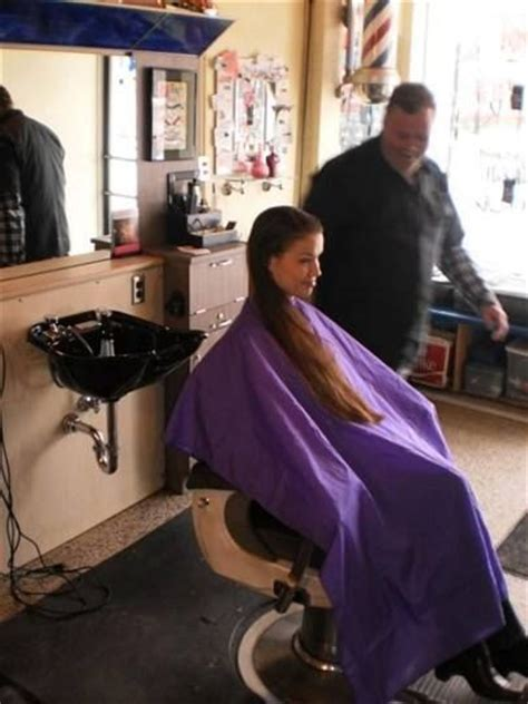 female in barber chair getting buzzcut peignoir mauve capes pinterest mauve and shorts