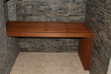 teak bench built into wall for support on one side