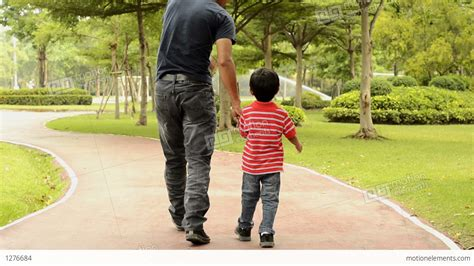 captain capsulitis dad and son walking father and son walking together stock