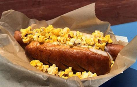dogs and popcorn dodgers now selling pop fly in a pretzel bun covered with cheese