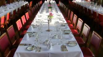 Place settings at a large formal dinner the host and hostess may be