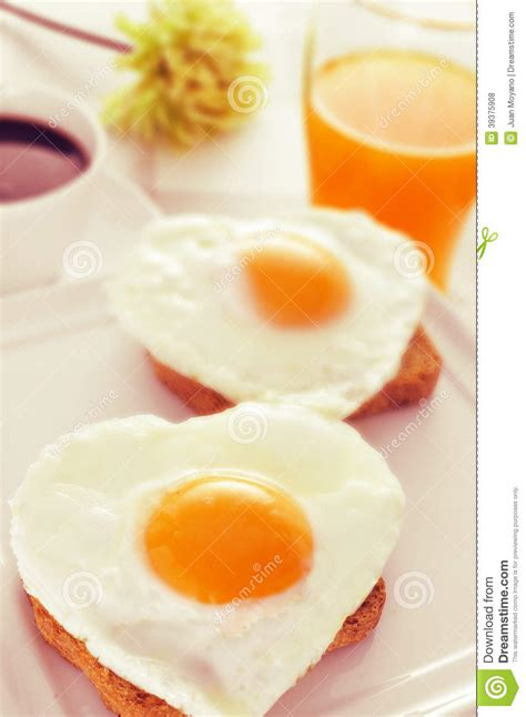 Heart shaped Fried Eggs, Bread And Orange Juice Stock Photo   Image: 39375908