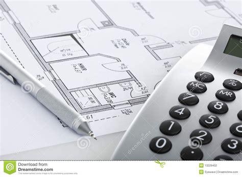 floor plan calculator pencil and calculator on blueprint of floor plan stock