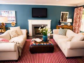 Blue living room with red striped area rug a red striped rug defines