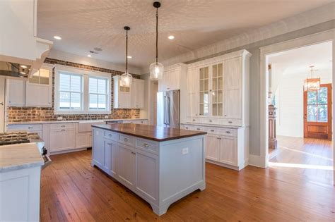 kitchen with white cabinets marble countertops wood