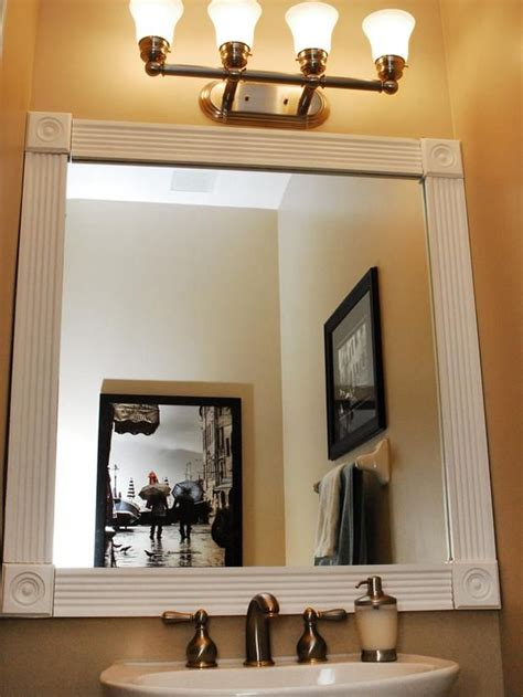 trim around bathroom mirror dress up your bathroom mirror by adding molding around the