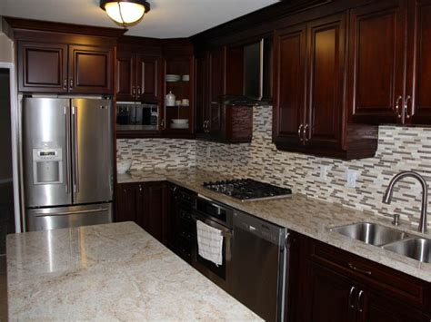 cherry wood kitchen cabinets with black granite stand alone baths dark cherry kitchen cabinets with