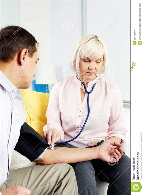 measuring blood pressure at home royalty free stock images
