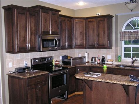 black stained kitchen cabinets best 25 staining oak cabinets ideas on
