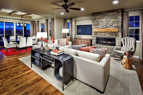 great room definition a rustic fireplace and wood beams define this great room and dining space new homes by