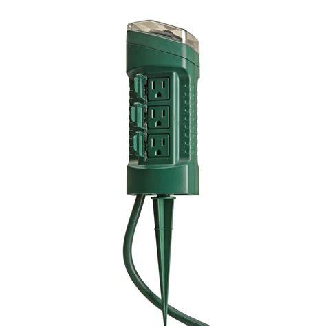 setting christmas lights on a timer woods outdoor 6 outlet yard stake with photocell light sensor timer and 6 ft cord green 13547