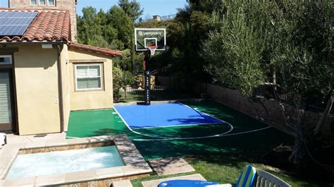 small basketball court in backyard small backyard basketball court installation by snapsports