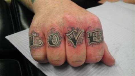 tattoo love on hand love knuckle tattoo on right hand