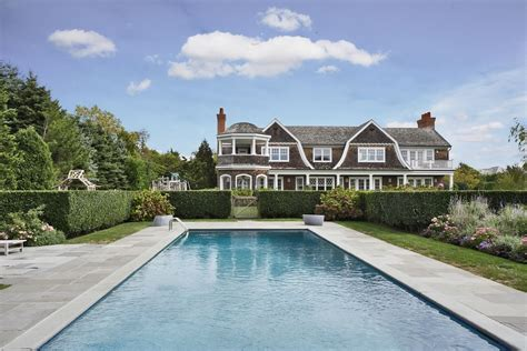 buying a new house and renting the old one jennifer lopez buying 10 million mansion in htons zillow porchlight