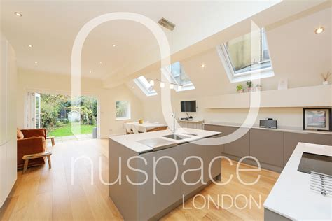 kitchen side extension chiswick with sloping roof and