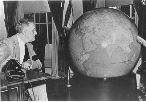 Fdr Oval Office examining his globe which he had placed near his oval office desk