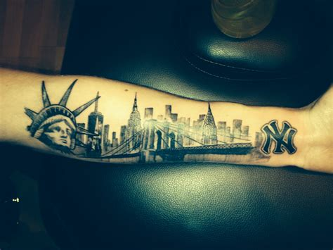 nyc skyline tattoo on my arm statue of liberty one world