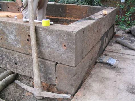 Fixing Sleepers how to build a raised pond with railway sleepers