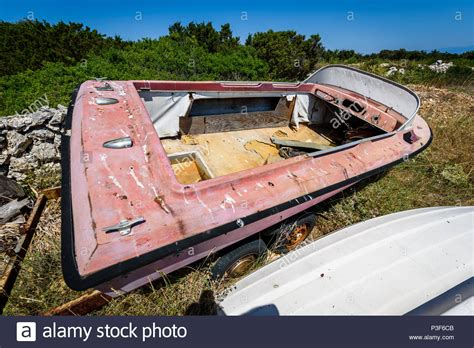old boat graveyard old abandoned wrecked speed boat at ship or boat graveyard