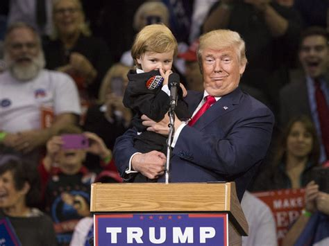 donald trump holding little boy trump a great role model inspite of media liars the