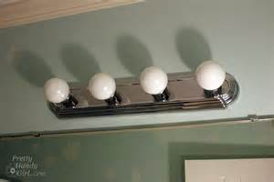 Bathroom Light Fixture With Outlet - changing out a light fixture bye bye hollywood strip light pretty handy