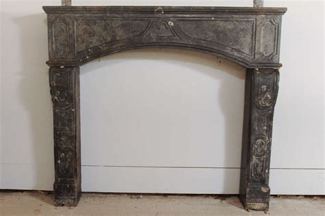 early 18th c marbleized limestone fireplace