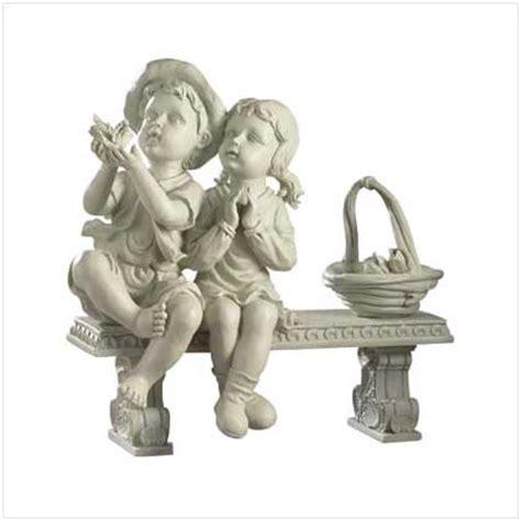 little girl sitting on bench statue home www waterplantsforponds com