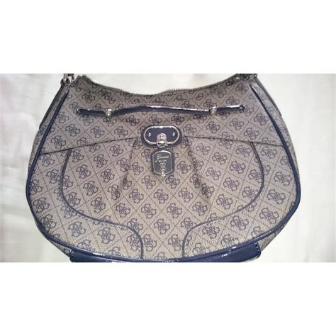 Other Designers Guess Who The by Guess Handbags Handbags Cloth Other Ref 5791 Joli Closet