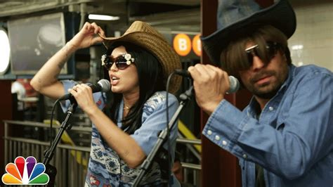 Mayer In Disguise by Miley Cyrus And Jimmy Fallon Peform On Subway Platform