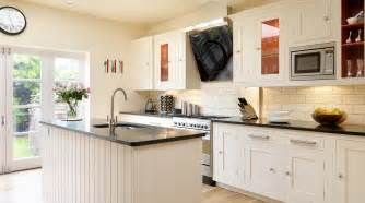 white shaker kitchen cabinets pictures white shaker kitchen with red interiors from harvey jones