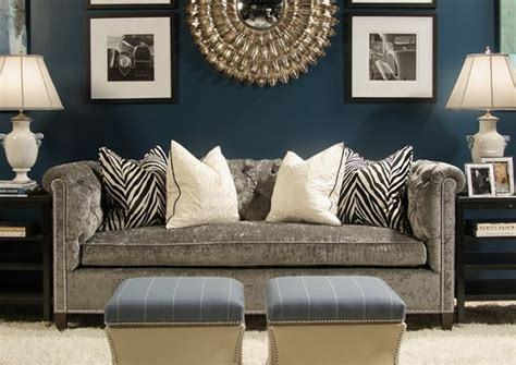 teal accent wall with black and brown furniture for the home pinterest living rooms blue dark teal walls gray sofa and gold accents love this
