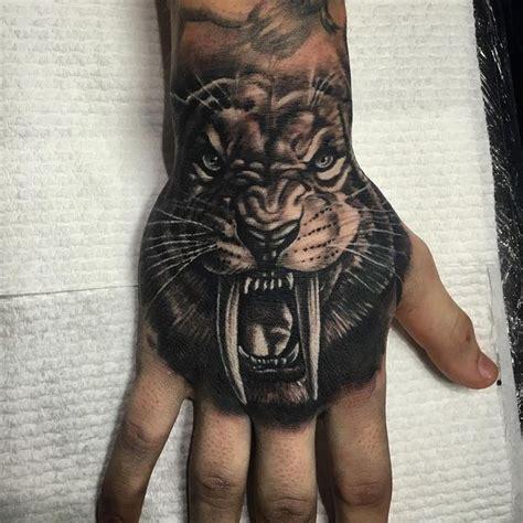 saber tooth tiger tattoo tiger meaning and best designs flowertattooideas