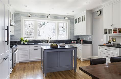 favorite cities kitchens baths mpls st paul magazine white kitchen with large window and small gray island midwest home magazine